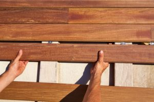 Wood Siding Installation by worker